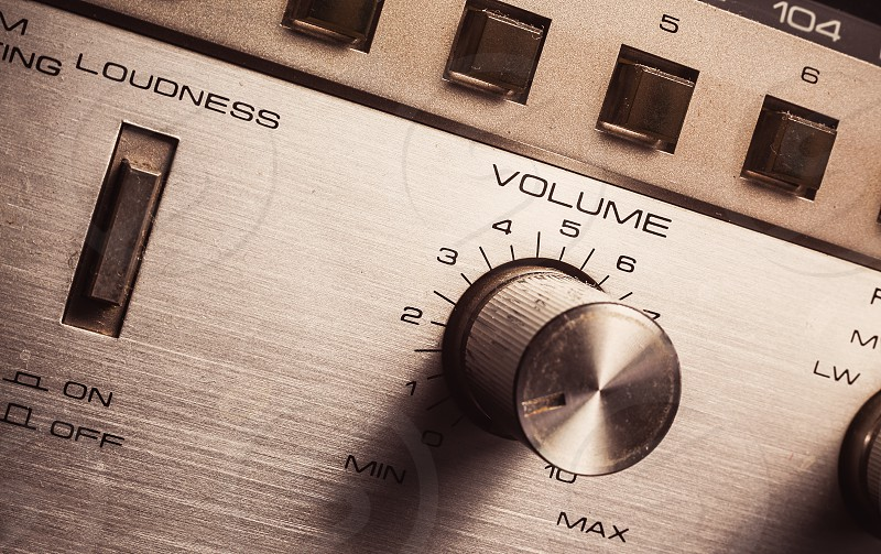 Details of an old radio receiver close up view on volume pot and loudness button.  photo