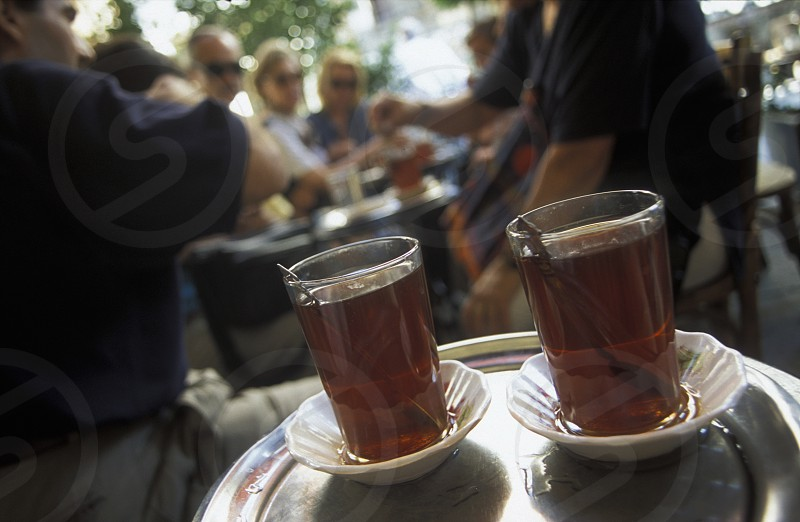 a coffee or teahouse in the market or souq in the old town in the city of Damaskus in Syria in the middle east photo