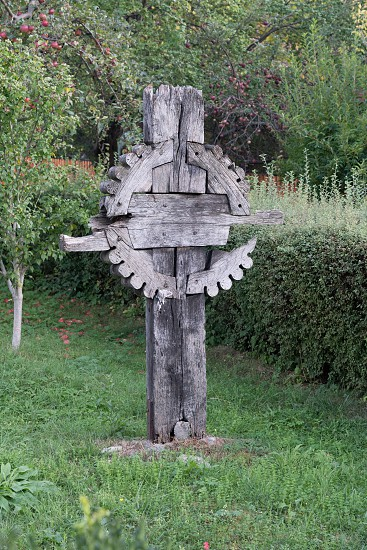 SIBIEL TRANSYLVANIA/ROMANIA - SEPTEMBER 16 : View of a wooden cross in the grounds of the Holy Trinity Church in Sibiel Transylvania Romania on September 16 2018 photo