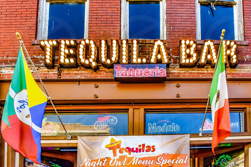 Ybor City Tampa Bay Florida. January 19  2019  Tequila Bar and Colorful flags in 7th Ave. photo