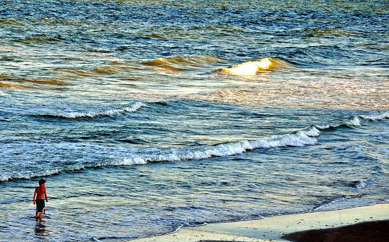 Boy walking in the waves - Myrtle Beach South Carolina (USA) photo