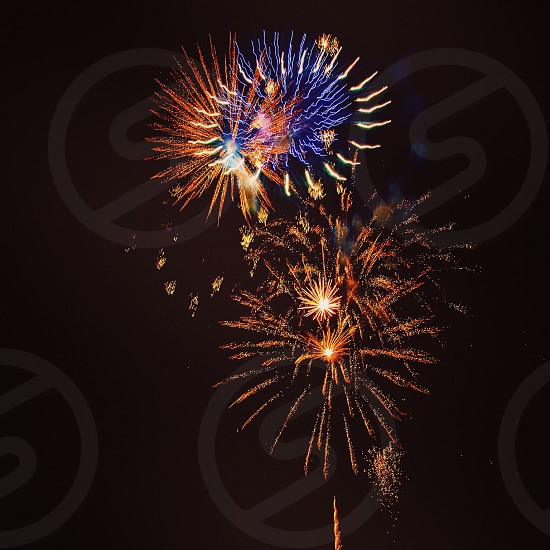 red blue yellow orange fireworks in black sky photo