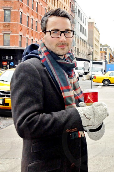 young business man professional on NYC streets drinking Starbucks coffee photo