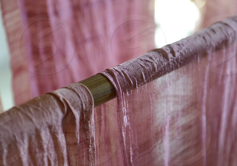 a silk production in the city of chiang mai in the north of Thailand in Southeastasia.  photo