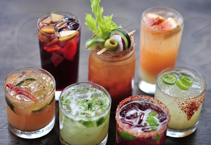 Cocktails beverages drinks food and drinks mixed drinks events festivities celebrations party's friends family restaurant social drink cups presentation  photo