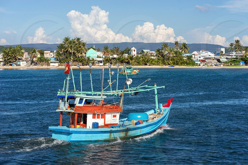 Local vietnamese fishing motor boat for catching squid and fish photo