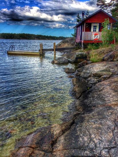 StockholmarchipelagoSwedensummerseabridgeviewhousecliffsrockclouds photo