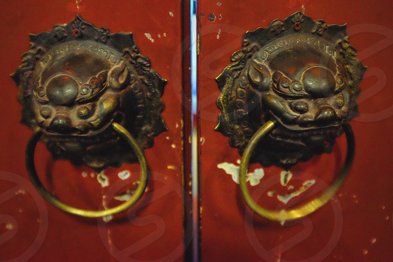 two brass-colored door knockers photo