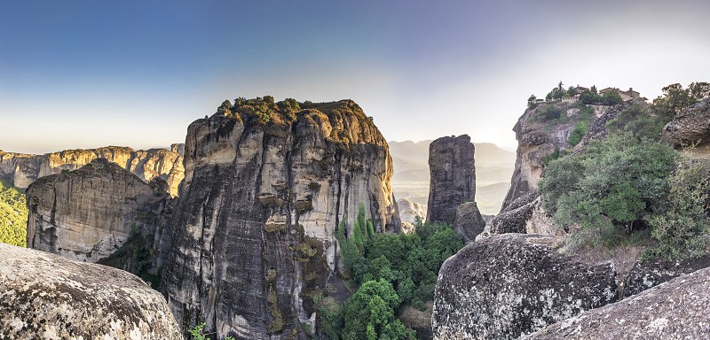 Panoramic view of the Great Meteoron Monastery in Meteora Kalambaka town in Greece on a summer evening photo