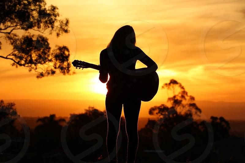Guitar sunset photo