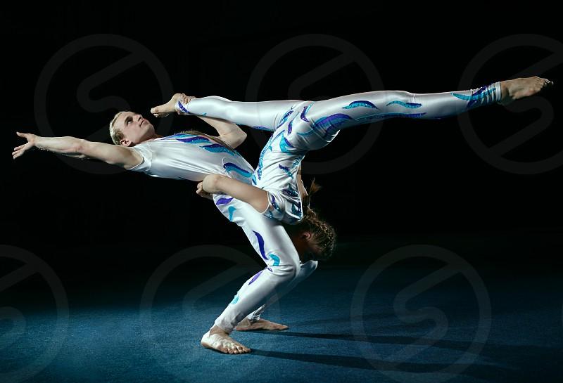 Circus artists perform different tricks. Gym split. photo