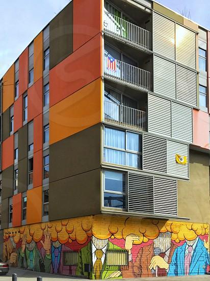 Graffiti on a multi-colored building. photo