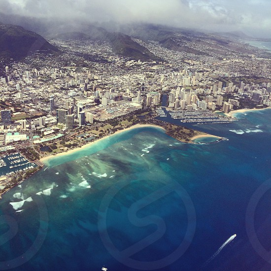 This shot was taken when I left Hawaii to attend my friend's wedding in San Francisco. This is an aerial view Ala Moana Beach Park. photo