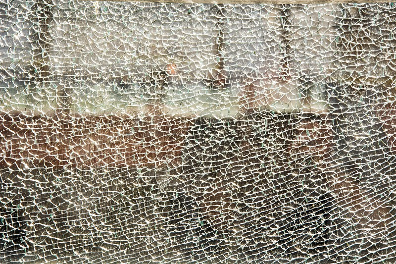 Close up of a broken tempered glass photo