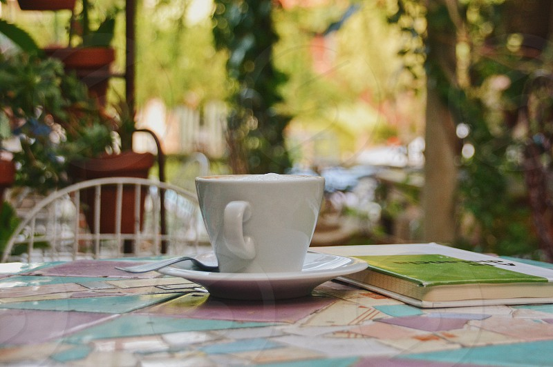 Coffee cup table summer backyard breakfast coffee time photo