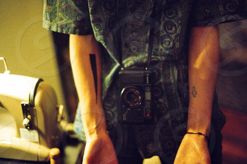Compact film camera & tatoo. photo