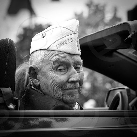 grayscale soldier driving car photograph photo