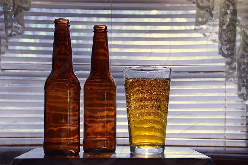 Kitchen window with a craft beer poured in a glass. photo