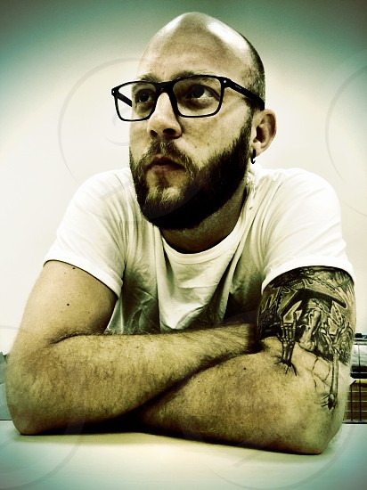 man in white round neck shirt with black framed eyeglasses photo