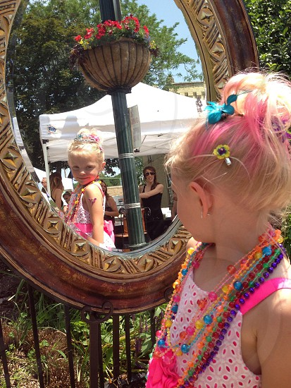 Young child in mirror photo