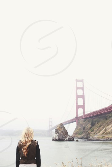 woman staring at the golden gate bridge photo