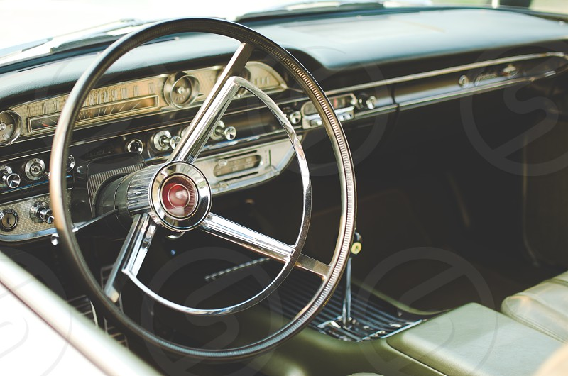 Interior steering wheel of a classic car.  photo