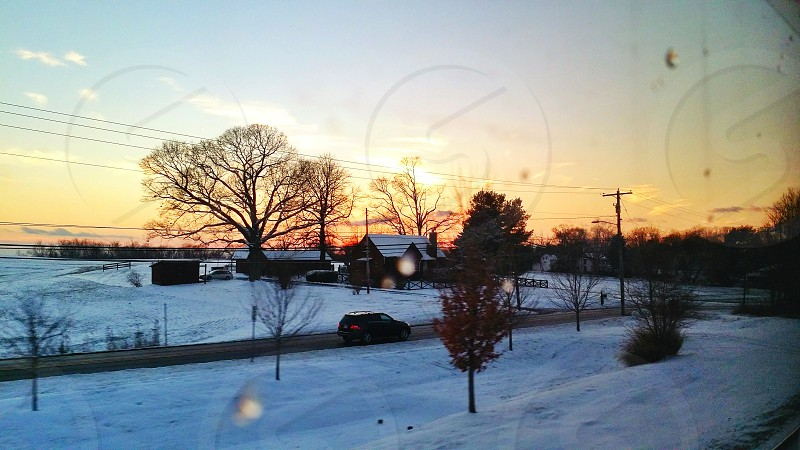Road trip snow road country sunset desk evening outdoors winter train sky rural window travel traveling photo