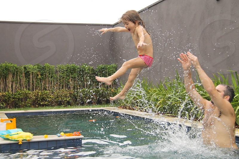 girl in pink pantie on swimming pool photo