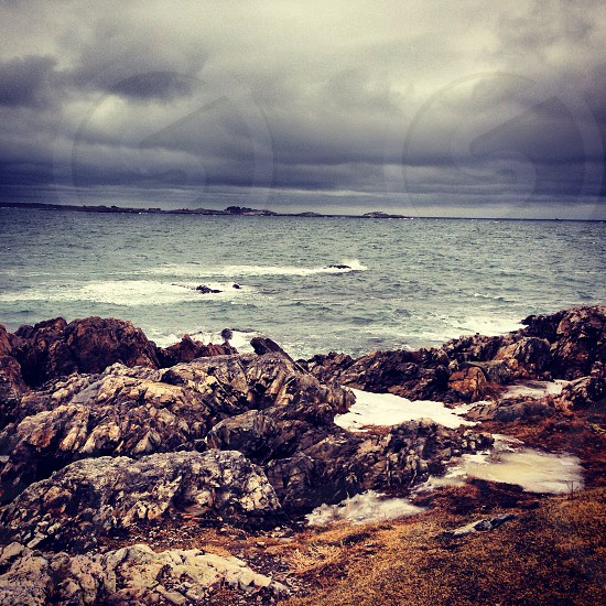 Gray clouds above ocean water photo
