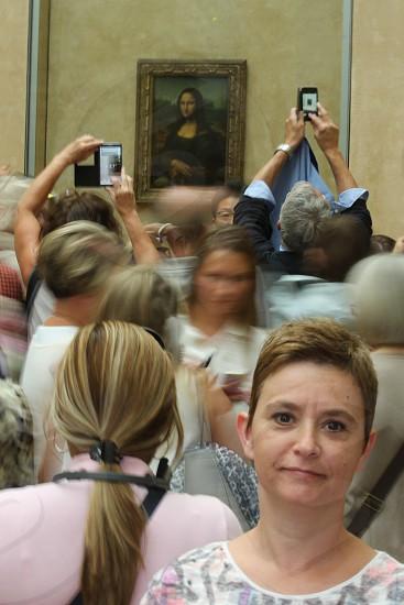 people taking photo of Monalisa painting by Leonardo da Vinci photo