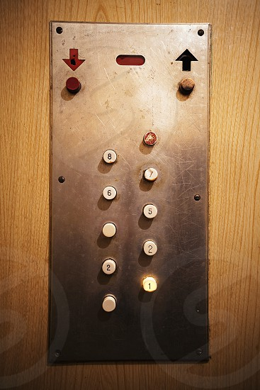 Details of an old elevator close-up view on elevator buttons.  photo