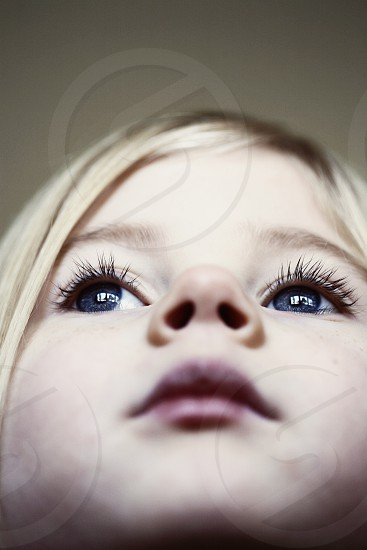 eyes close up on eyes close up macro eyelashes little girl dream looking up pensive dreamy  photo
