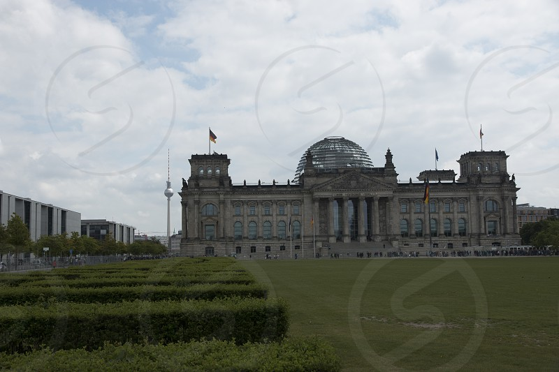 Front of the Seat of German Parliament and historical building with glass dome Reichstag building - Berlin photo