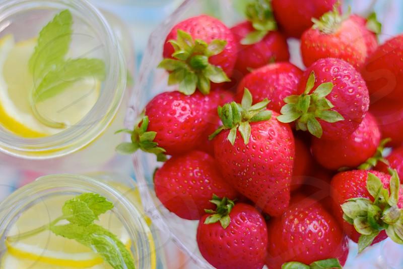 Snacking on fresh strawberries photo