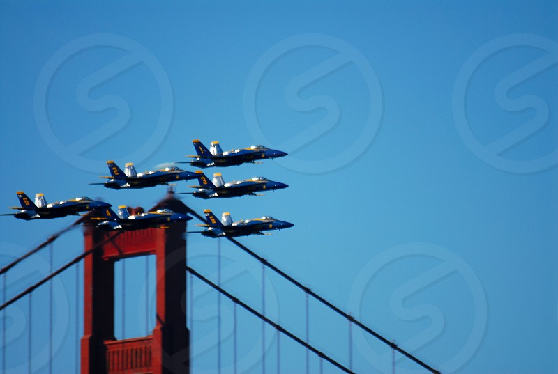 jets flying over bridge photo