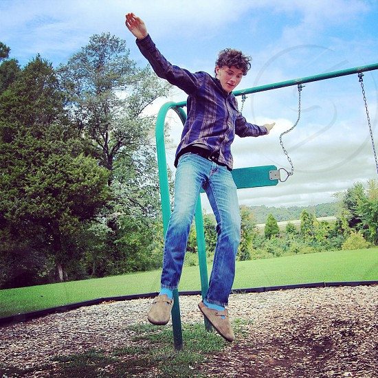 Swing jump free fall play park photo