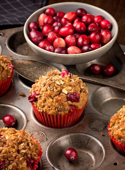 Freshly baked cranberry muffins with oatmeal crumble topping photo