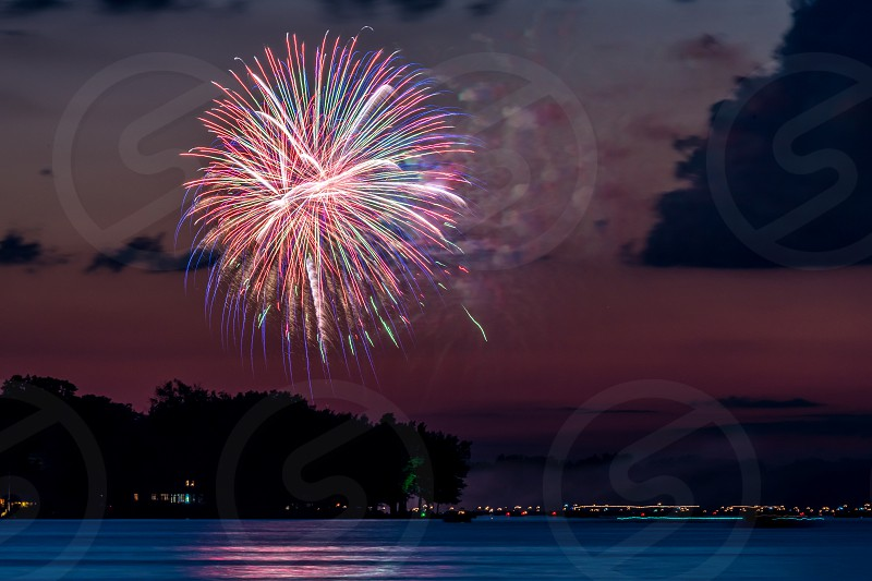 Fireworks at twilight over a lake in Ohio. photo