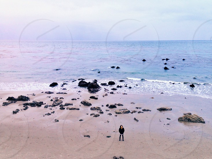 woman in black jacket at the seashore  photo
