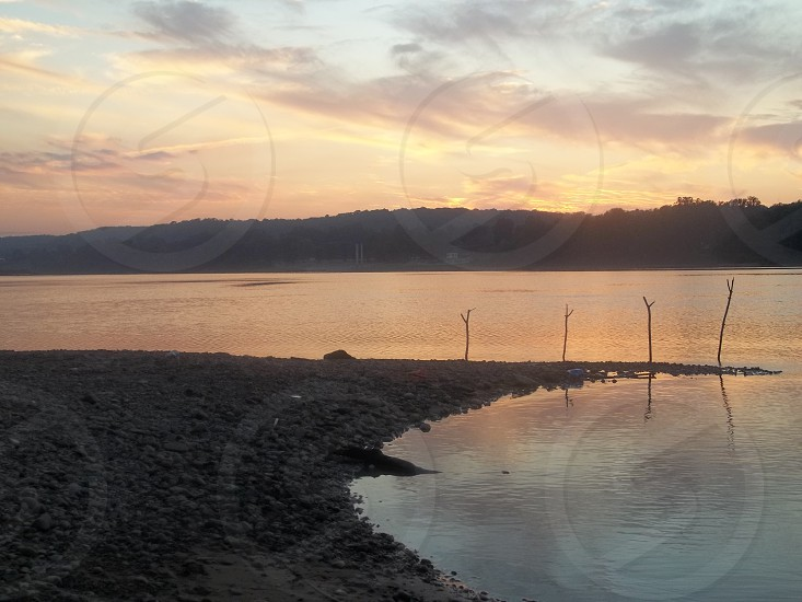 Lazy day on the Ohio River at sunset for fishing.  photo