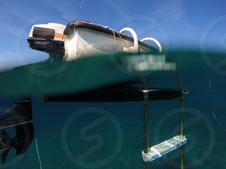 Closeup shot of boat floating on clear blue Adriatic sea photo