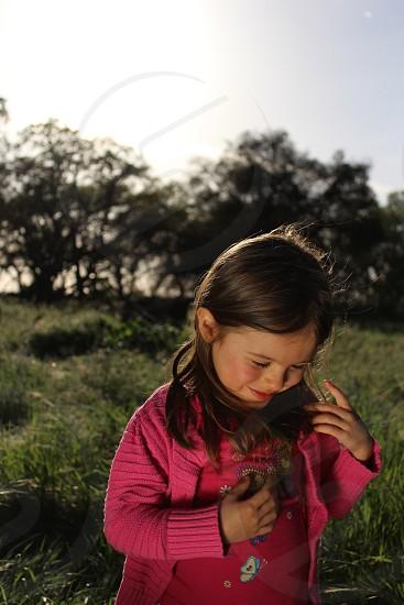 Child smiles outdoors sunshine girl  photo