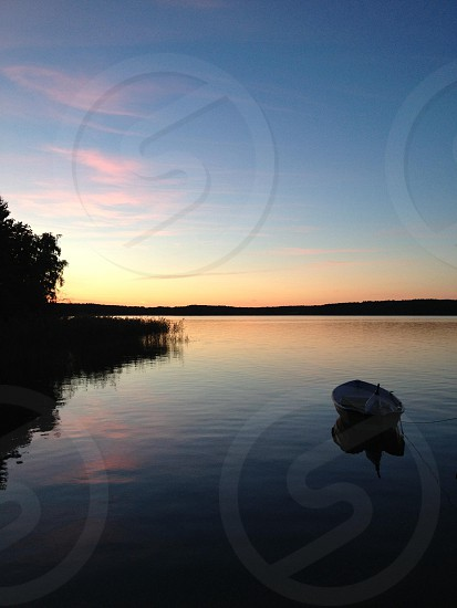 white sail boat on lake view photo