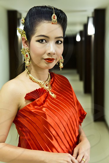 Pretty Asian lady in red dress Chinese new year party model modeling clothing fashion portrait reception 1 photo