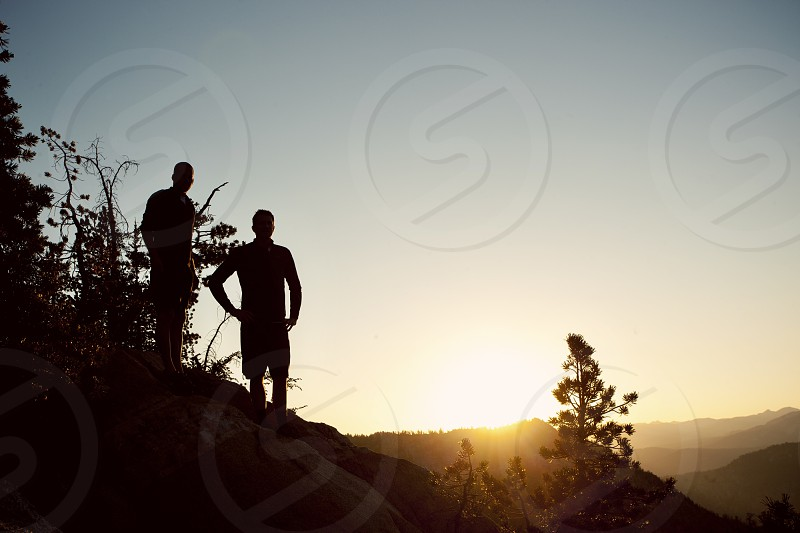 Hikers silhouetted in the mountains photo