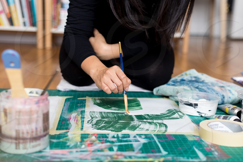 Job editorial - painting in the studio.  photo