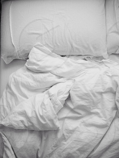 white pillow and blanket photo