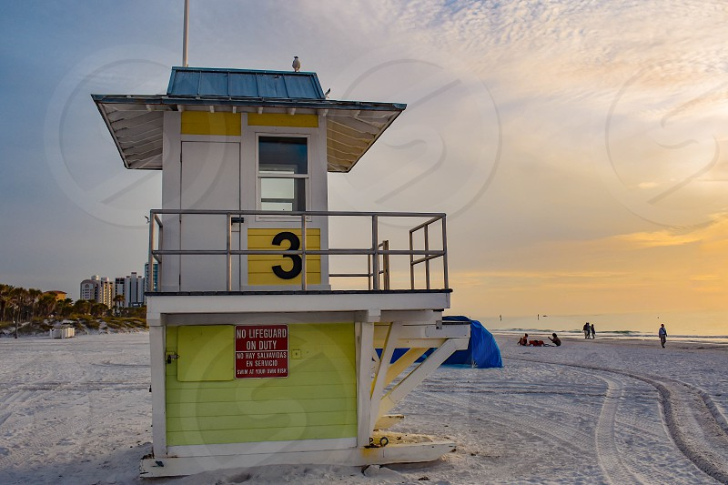 Clearwater Beach Florida. January 25 2019 Lifeguard station on sunset  cloudy background in Gulf Coast Beaches . photo
