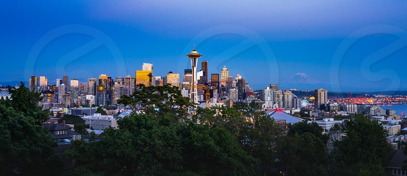 This is the picture of Seattle skyline with Mount Rainier in the background during sunset. photo