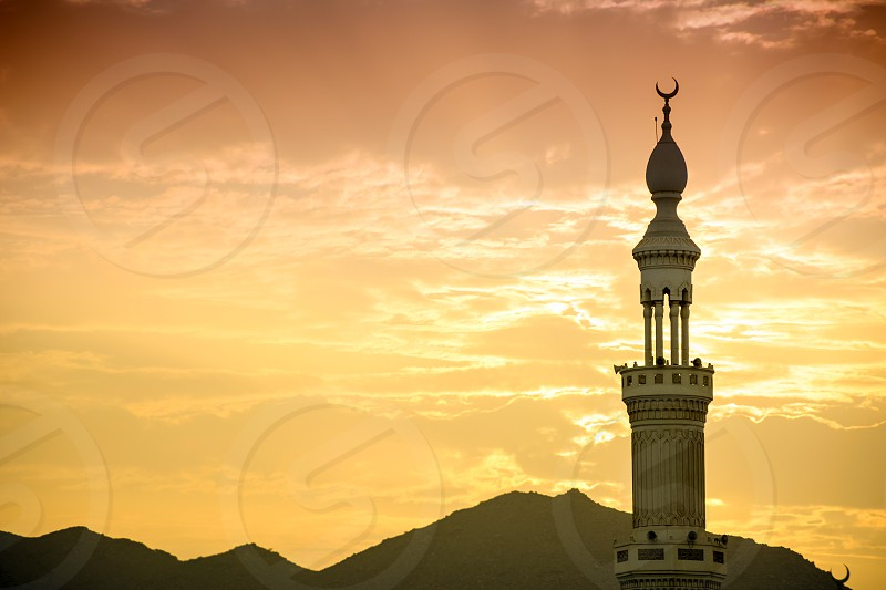 top of mosque in uae under the sun set photo